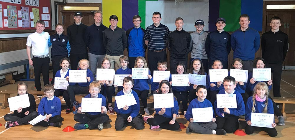 Professional golf degree students coach primary school
