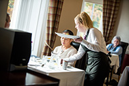 Hospitality student during service at Burghfield Hotel