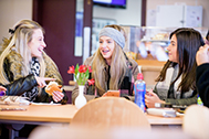 Students sitting at a table in Cafe at Morven