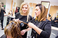 Hairdressing students with client at House of Morven